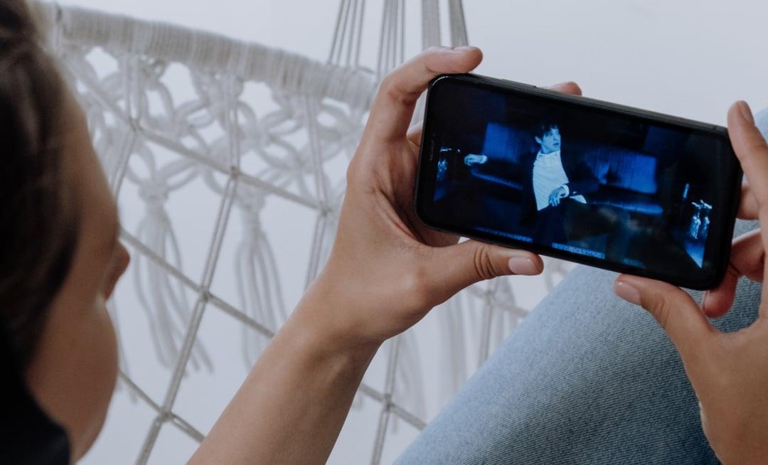 watching video marketing phone